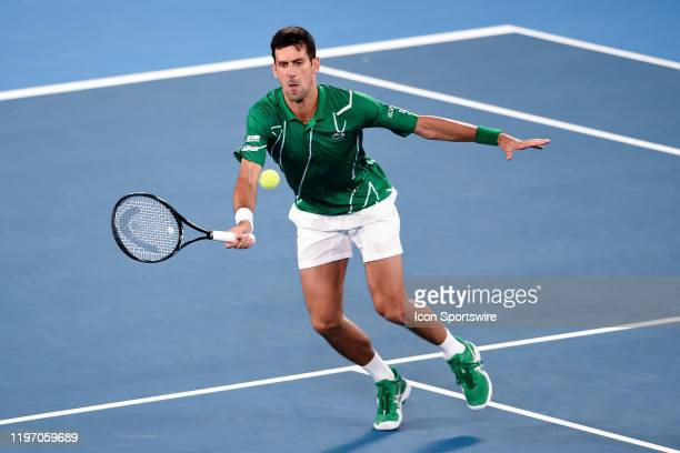 Novak Djokovic of Serbia hits a volley during quarterfinals of the Australian Open Tennis at Melbourne Park Tennis Centre on January 28, 2020 in...