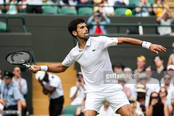 Novak Djokovic of Serbia hits the ball into the crowd after his Men's Singles third round match against Hubert Hurkacz of Poland during Day five of...