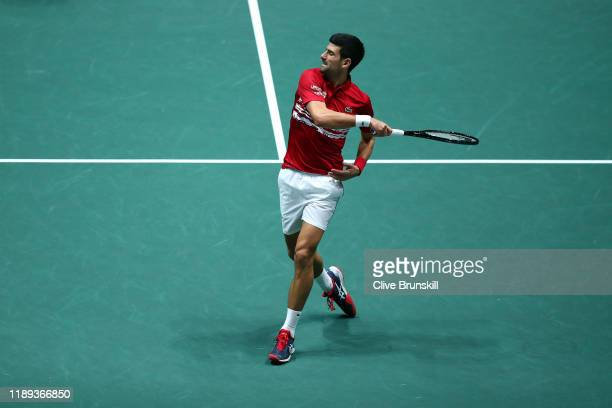 Novak Djokovic of Serbia hits the ball into the crowd during his quarter final doubles match against Russia on Day Five of the 2019 Davis Cup at La...