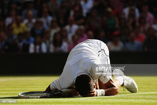 Novak Djokovic of Serbia holds his head in hands during the Gentlemen's Singles Final match against Roger Federer of Switzerland on day thirteen of...