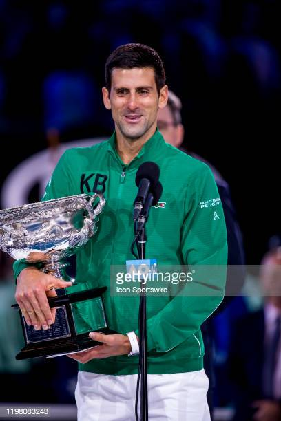 Novak Djokovic of Serbia holds his trophy while speaking to the crowd after winning the finals of the 2020 Australian Open on February 2 2020 at...