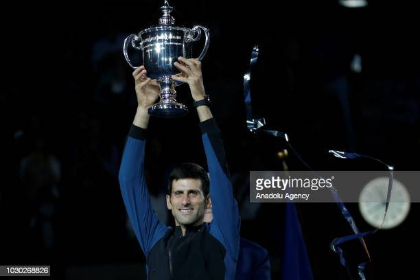 Novak Djokovic of Serbia holds the championship trophy after winning his men's singles finals match against Juan Martin Del Potro of Argentina at US...