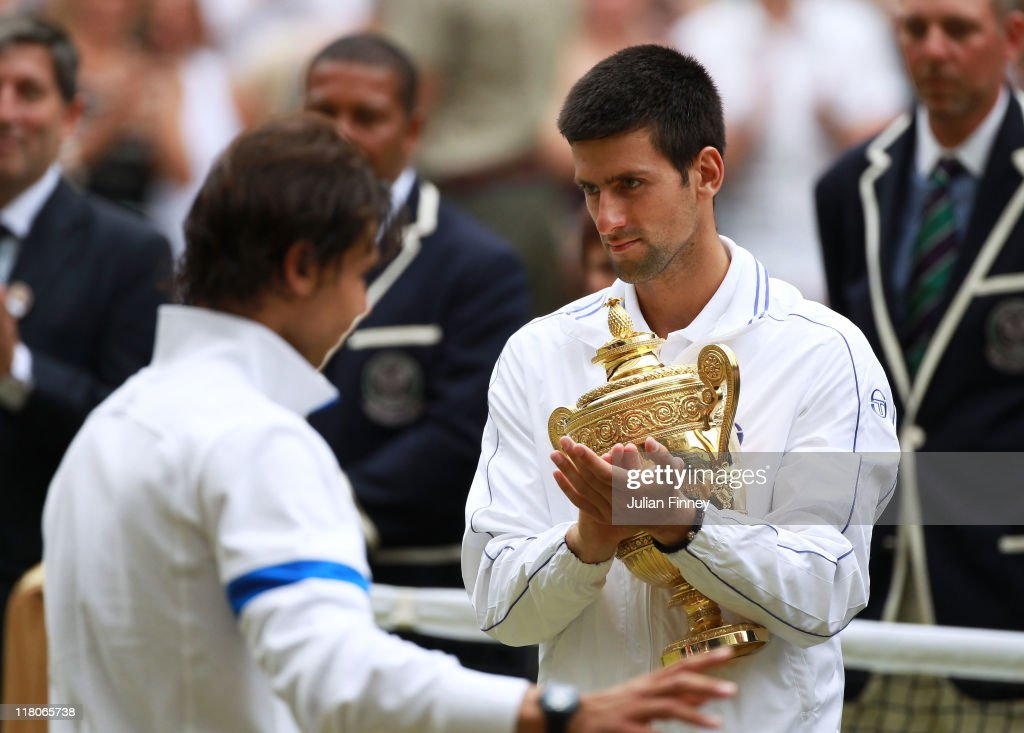 Novak Djokovic of Serbia holds the championship trophy after winning his final round Gentlemen's match against Rafael Nadal of Spain on Day Thirteen of the Wimbledon Lawn Tennis Championships at the All England Lawn Tennis and Croquet Club on July 3, 2011 in London, England.