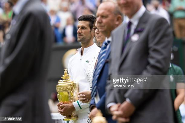 Novak Djokovic of Serbia holds the championship trophy during the ceremony for the Men's Singles Final against Matteo Berrettini of Italy at The...