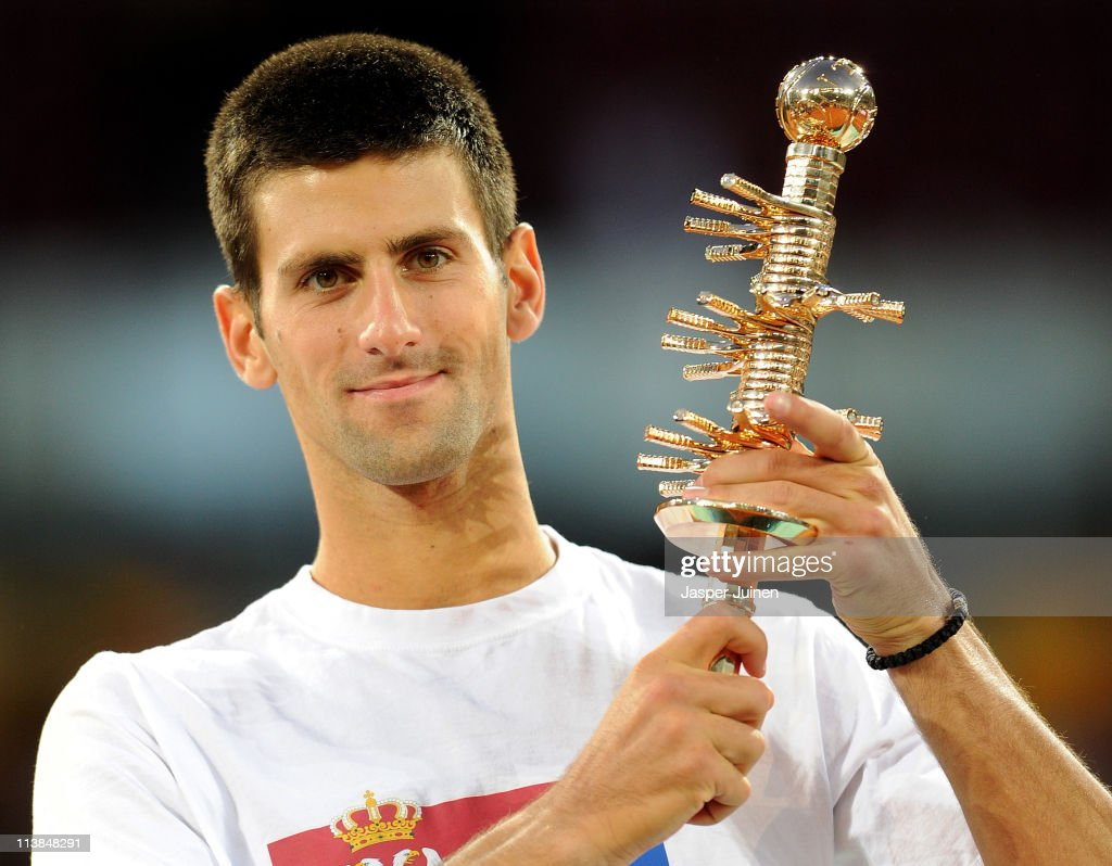 Novak Djokovic of Serbia holds the Ion Tiriac's trophy aloft after winning his final match against Rafael Nadal of Spain in straight sets during day eight of the Mutua Madrilena Madrid Open Tennis on May 8, 2011 in Madrid, Spain.