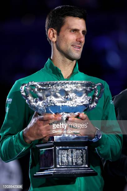 Novak Djokovic of Serbia holds the Norman Brookes Challenge Cup after winning the Men's Singles Final against Dominic Thiem of Austria on day...