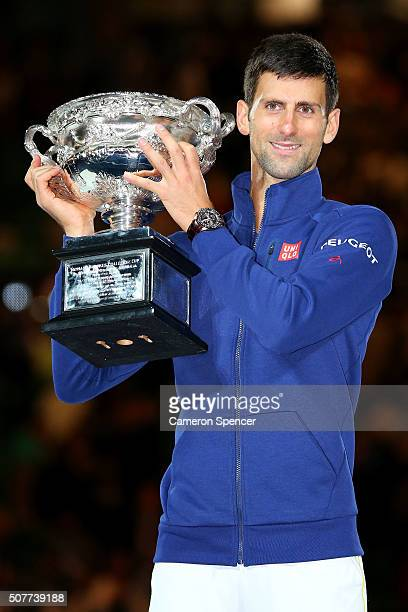 Novak Djokovic of Serbia holds the Norman Brookes Challenge Cup after winning the Men's Singles Final over Andy Murray of Great Britain during day 14...