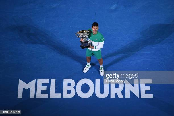 Novak Djokovic of Serbia holds the Norman Brookes Challenge Cup as he celebrates victory in his Men's Singles Final match against Daniil Medvedev of...