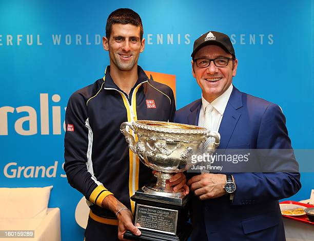 Novak Djokovic of Serbia holds the Norman Brookes Challenge Cup with actor Kevin Spacey in the changerooms after winning his men's final match...