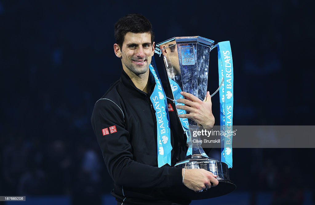 Novak Djokovic of Serbia holds the trophy after his men's singles final match against Rafael Nadal of Spain during day eight of the Barclays ATP World Tour Finals at O2 Arena on November 11, 2013 in London, England.