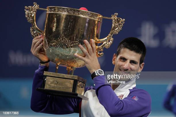 Novak Djokovic of Serbia holds the trophy aloft after defeating Carlos Jo-Wilfried Tsonga of France in the Men's Singles Final of the China Open at...