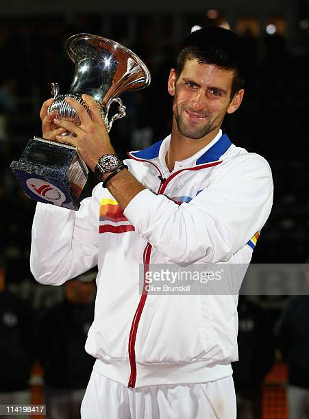 Novak Djokovic of Serbia holds the trophy aloft after his victory in the final against Rafael Nadal of Spain during day eight of the Internazoinali...