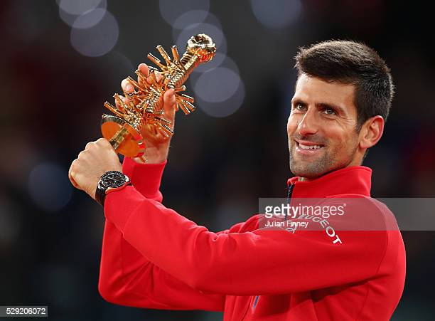 Novak Djokovic of Serbia holds the winners trophy after defeating Andy Murray of Great Britain in the final during day nine of the Mutua Madrid Open...