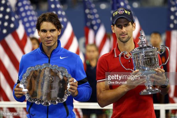 Novak Djokovic of Serbia holds up the winner's the trophy as Rafael Nadal of Spain holds up the runner up award after Djokovic defeated Nadal during...