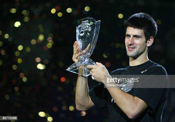 Novak Djokovic of Serbia holds up the winner's trophy following his victory over Nikolay Davydenko of Russia at the men's singles final match in the...