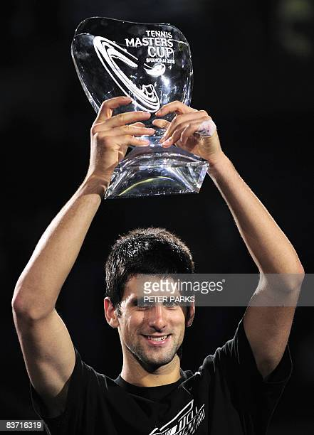 Novak Djokovic of Serbia holds up the winner's trophy following his victory over Nikolay Davydenko of Russia in the men's singles final at the ATP...