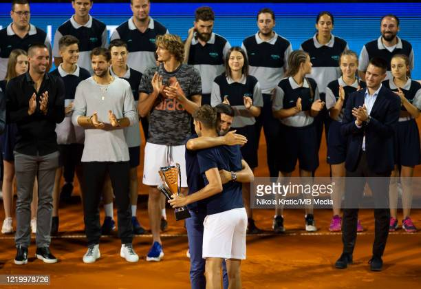 Novak Djokovic of Serbia hugs Filip Krajinovic of Serbia after awarding the cup for second place on June 14 during the 3rd day of Summer Adria Tour...