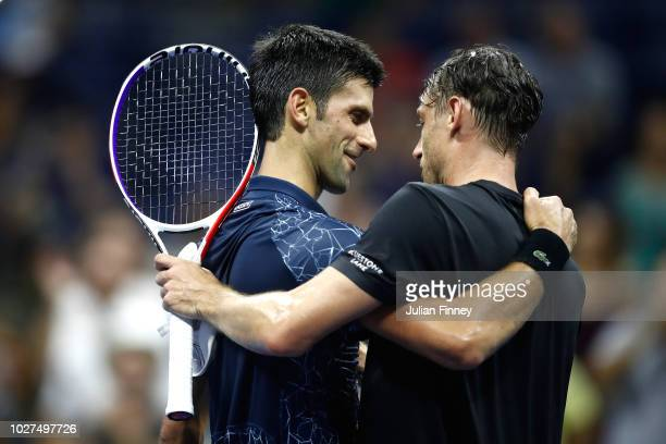 Novak Djokovic of Serbia hugs John Millman of Australia after their men's singles quarterfinal match against on Day Ten of the 2018 US Open at the...