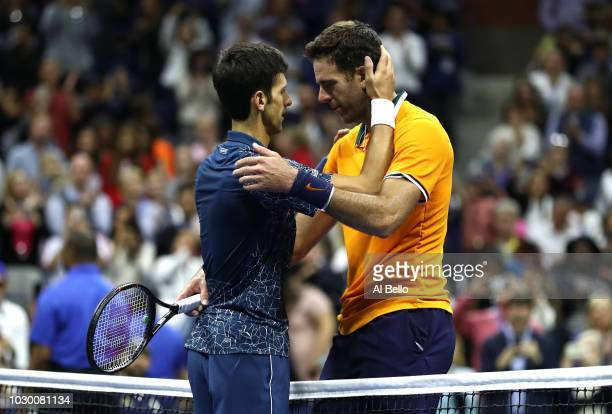 Novak Djokovic of Serbia hugs Juan Martin del Potro of Argentina after their men's Singles finals match on Day Fourteen of the 2018 US Open at the...