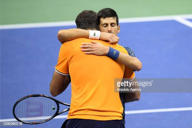 Novak Djokovic of Serbia hugs Juan Martin del Potro of Argentina after their men's singles finals match at US Open 2018 in New York United States on...