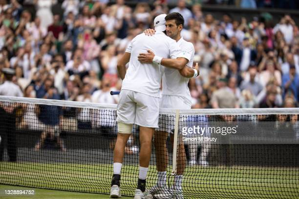 Novak Djokovic of Serbia hugs Matteo Berrettini of Italy at the net after his victory during the Men's Singles Final at The Wimbledon Lawn Tennis...