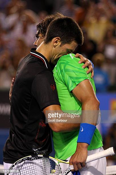 Novak Djokovic of Serbia hugs Raphael Nadal of Spain after his men's final match against Rafael Nadal of Spain during day fourteen of the 2012...