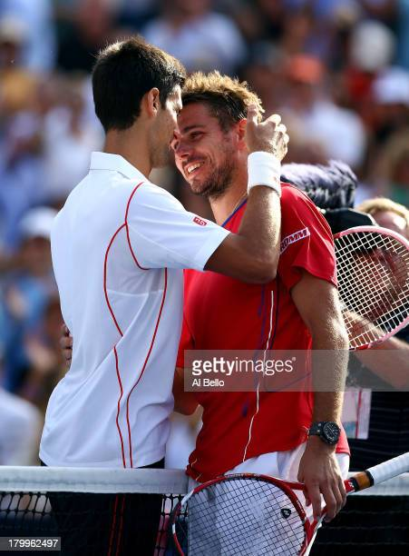 Novak Djokovic of Serbia hugs Stanislas Wawrinka of Switzerland after winning his men's singles semifinal match on Day Thirteen of the 2013 US Open...