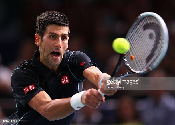 Novak Djokovic of Serbia in action against David Ferrer of Spain in the final during day seven of the BNP Paribas Masters at Palais Omnisports de...