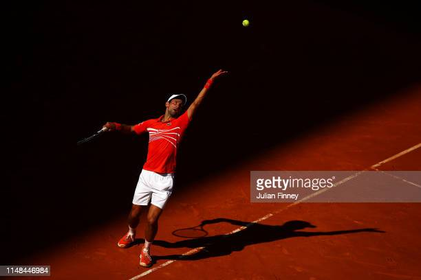 Novak Djokovic of Serbia in action against Dominic Thiem of Austria during day eight of the Mutua Madrid Open at La Caja Magica on May 11 2019 in...