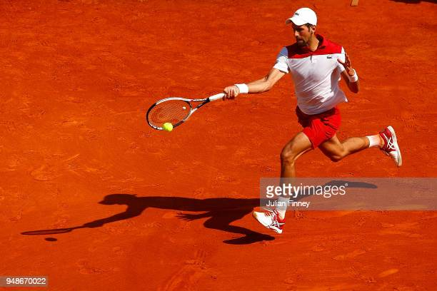 Novak Djokovic of Serbia in action against Dominic Thiem of Austria during his men's singles match on day five of the Rolex MonteCarlo Masters at...