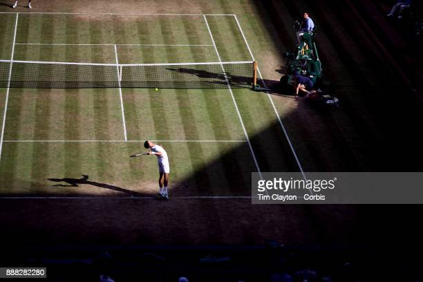 Novak Djokovic of Serbia in action against Ernests Glubis of Latvia on Centre Court in the Gentlemen's Singles Competition during the Wimbledon Lawn...