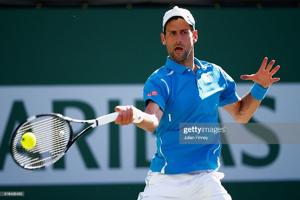Novak Djokovic of Serbia in action against Jo-Wilfried Tsonga of France during day twelve of the BNP Paribas Open at Indian Wells Tennis Garden on March 18, 2016 in Indian Wells, California.