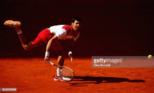Novak Djokovic of Serbia in action against Kei Nishikori of Japan in their first round match during day three of the Mutua Madrid Open tennis...