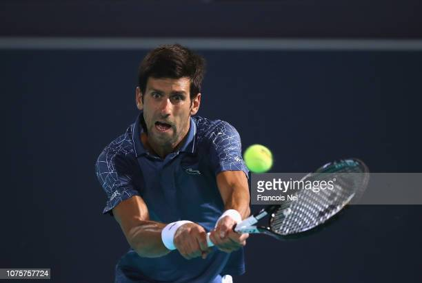 Novak Djokovic of Serbia in action against Kevin Anderson of South Africa during the men's final match of the Mubadala World Tennis Championship at...