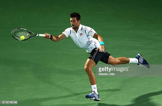 Novak Djokovic of Serbia in action against Malek Jaziri of Tunisia during day five of the ATP Dubai Duty Free Tennis Championship at the Dubai Duty...