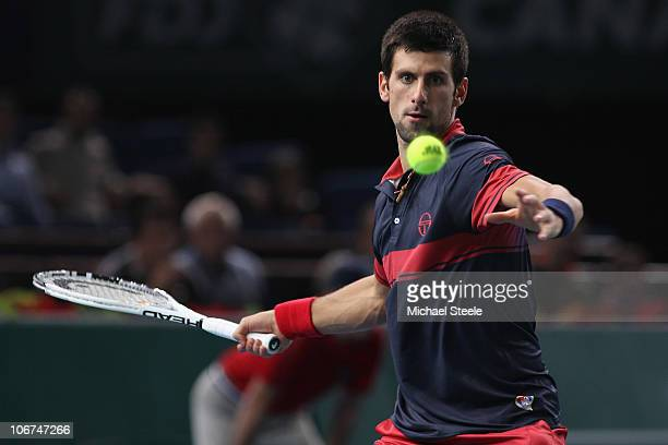 Novak Djokovic of Serbia in action against Michael Llodra of France during Day Five of the ATP Masters Series Paris at the Palais Omnisports on...