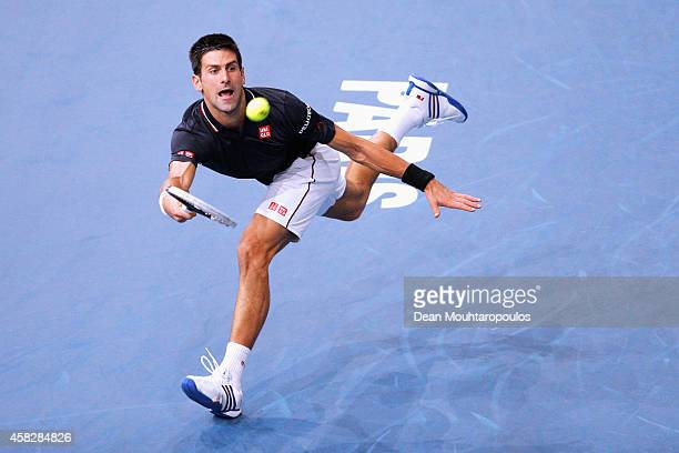 Novak Djokovic of Serbia in action against Milos Raonic of Canada in their Final match during day 7 of the BNP Paribas Masters held at the at Palais...