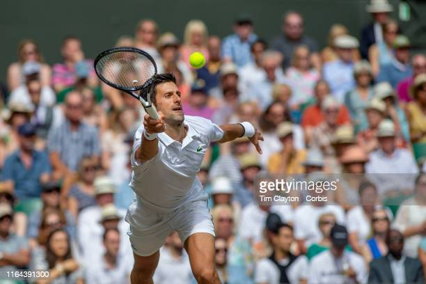 Novak Djokovic of Serbia in action against Roger Federer of Switzerland during the Men's Singles Final on Centre Court during the Wimbledon Lawn...