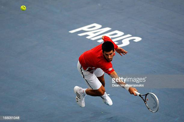 Novak Djokovic of Serbia in action against Sam Querrey of USA during day 3 of the BNP Paribas Masters at Palais Omnisports de Bercy on October 31,...