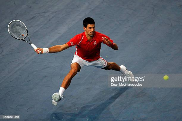 Novak Djokovic of Serbia in action against Sam Querrey of USA during day 3 of the BNP Paribas Masters at Palais Omnisports de Bercy on October 31...