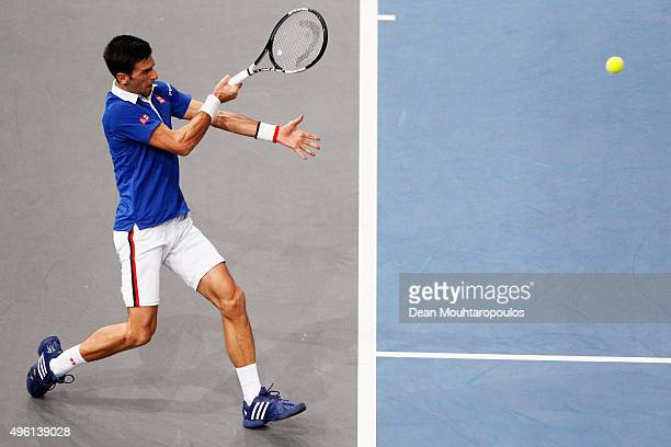 Novak Djokovic of Serbia in action against Stan Wawrinka of Switzerland in their semi final match during Day 6 of the BNP Paribas Masters held at...