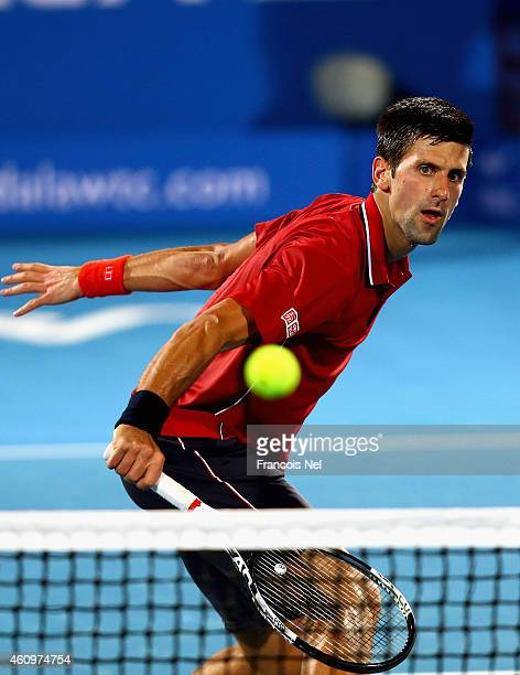 Novak Djokovic of Serbia in action against Stanislas Wawrinka of Switzerland during the semi final match of the Mubadala World Tennis Championship at...
