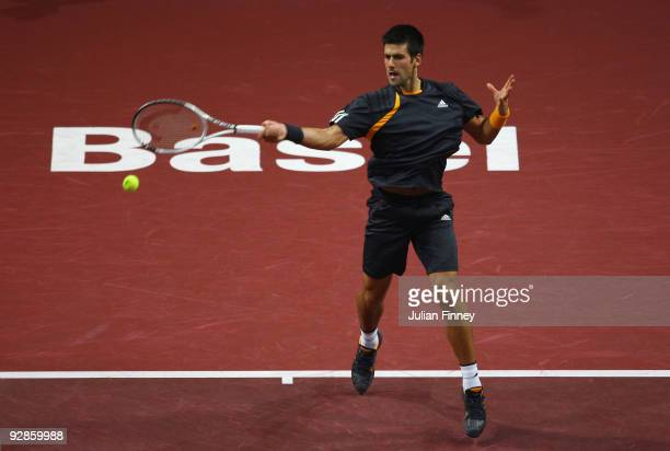 Novak Djokovic of Serbia in action against Stanislas Wawrinka of Switzerland during Day Five of the Davidoff Swiss Indoors Tennis at St Jakobshalle...