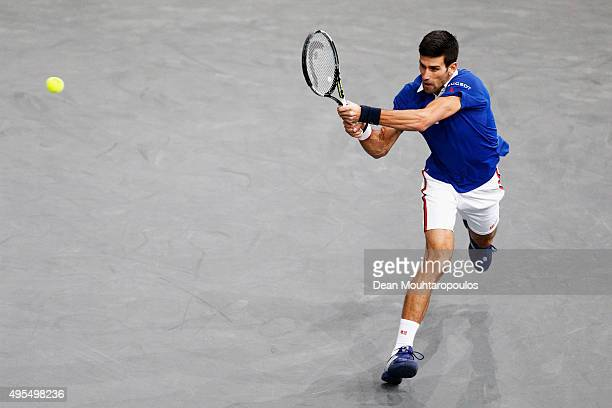 Novak Djokovic of Serbia in action against Thomaz Bellucci of Brazil during Day 2 of the BNP Paribas Masters held at AccorHotels Arena on November 3...