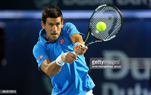 Novak Djokovic of Serbia in action against Vasek Pospisil of Canada during day two of the ATP Dubai Duty Free Tennis Championships at the Dubai Duty...
