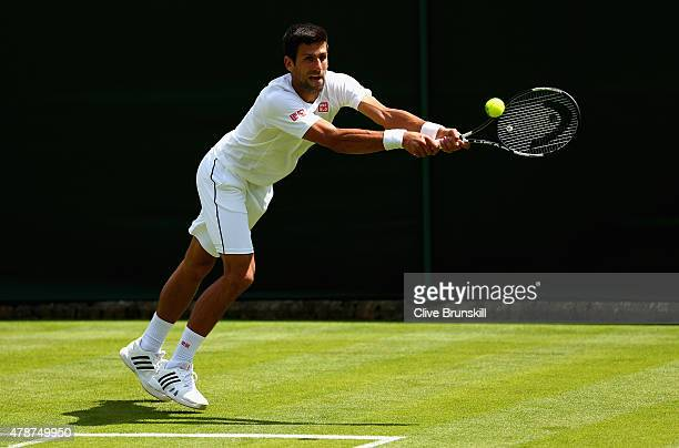 Novak Djokovic of Serbia in action during a practice session prior to the Wimbledon Lawn Tennis Championships at the All England Lawn Tennis and...