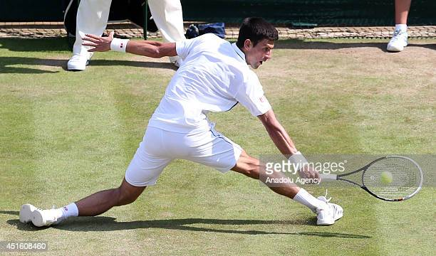 Novak Djokovic of Serbia in action during his Gentlemen's Singles quarterfinal match against Marin Cilic of Croatia on day nine of the Wimbledon...
