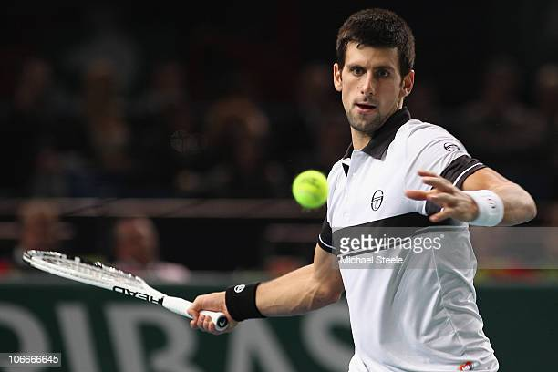 Novak Djokovic of Serbia in action during his match against Juan Monaco of Argentina during Day Four of the ATP Masters Series Paris at the Palais...