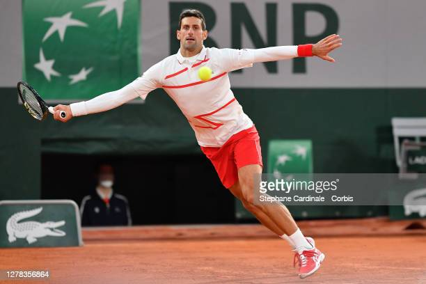 Novak Djokovic of Serbia in action during his Men's Singles third round match against Daniel Elahi Galan of Colombia on day seven of the 2020 French...