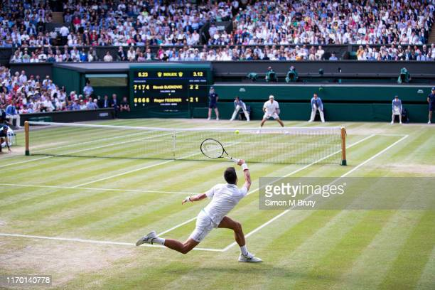 Novak Djokovic of Serbia in action during the Men's Singles Final against Roger Federer of Switzerland at The Wimbledon Lawn Tennis Championship at...